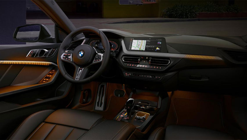 The golden illuminated interior of the BMW 2 Series Gran Coupe.
