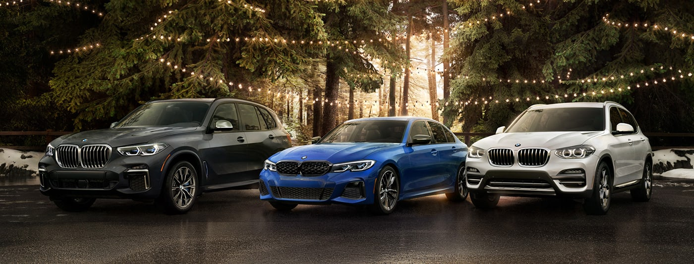 2021 BMW X3 X5 and 3-Series in a forest