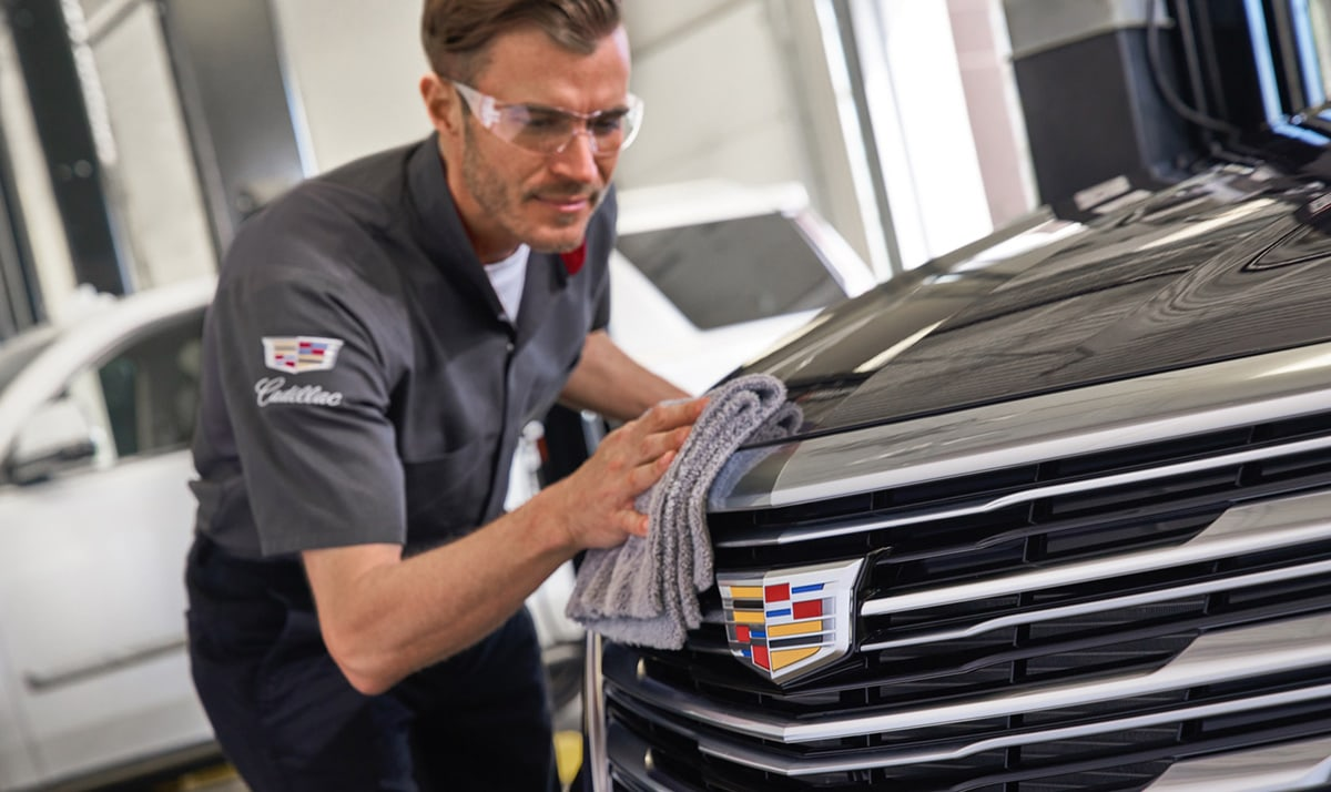 Cadillac Service Technician detailing a vehicle