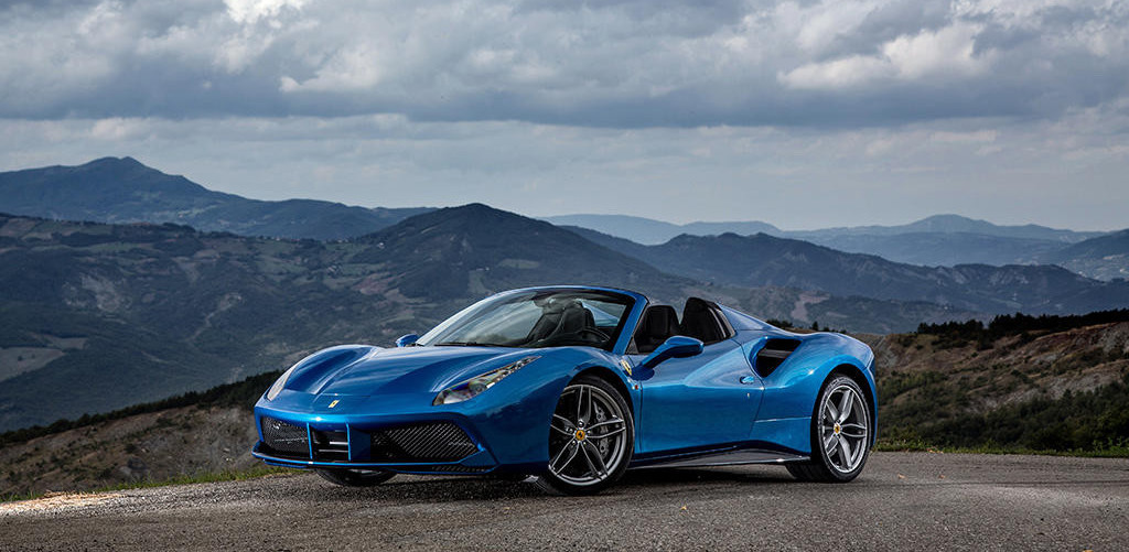 Ferarri 488 Spider parked by mountains