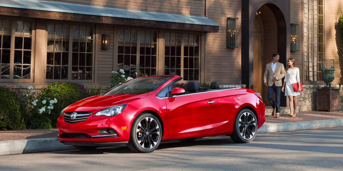 A red Buick Cascada parked on the street