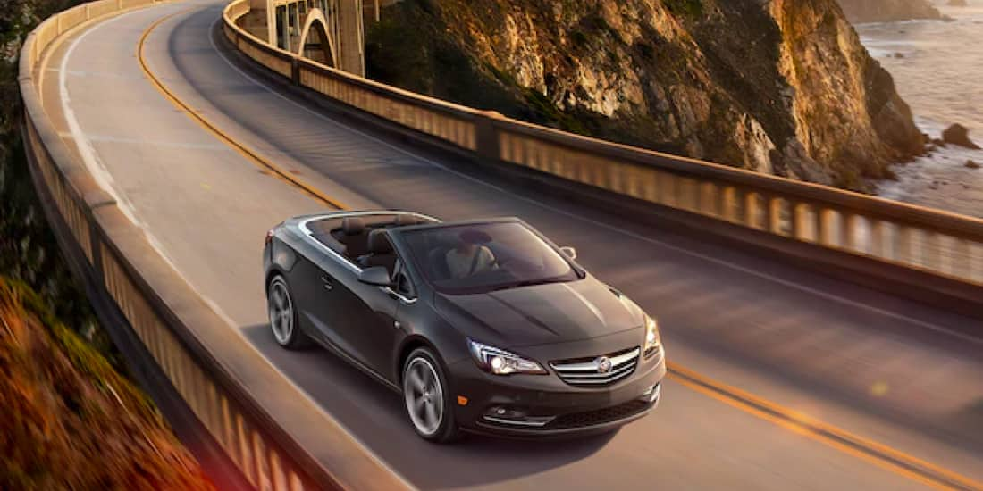 Buick Cascada Convertible driving down the highway