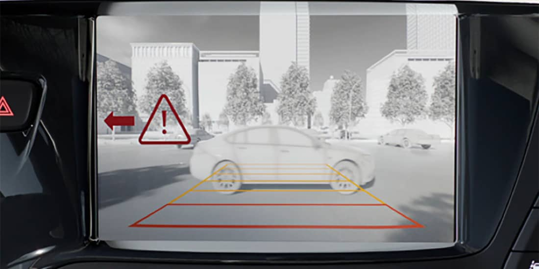 Graphic representation of a Buick Envision with rear cross traffic warning system