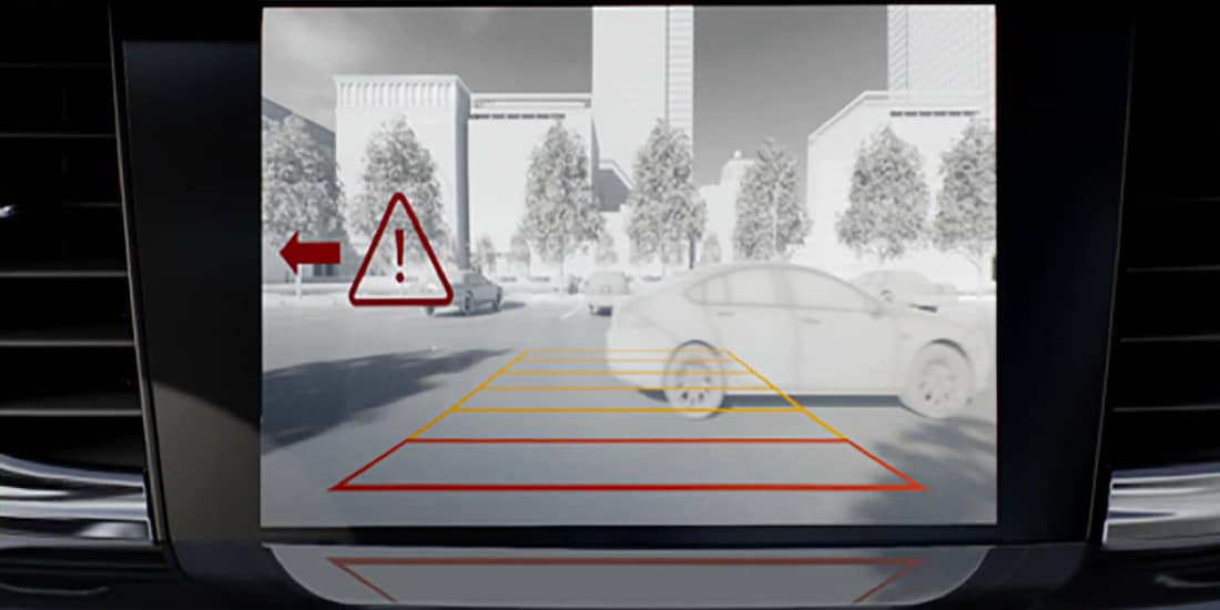 A graphic representation of a Regal Sportback with rear cross traffic alert