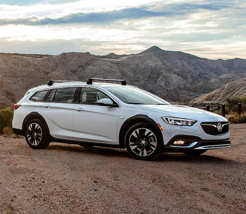 White 2019 Buick Regal TourX Angled View Parked in Front of Mountains
