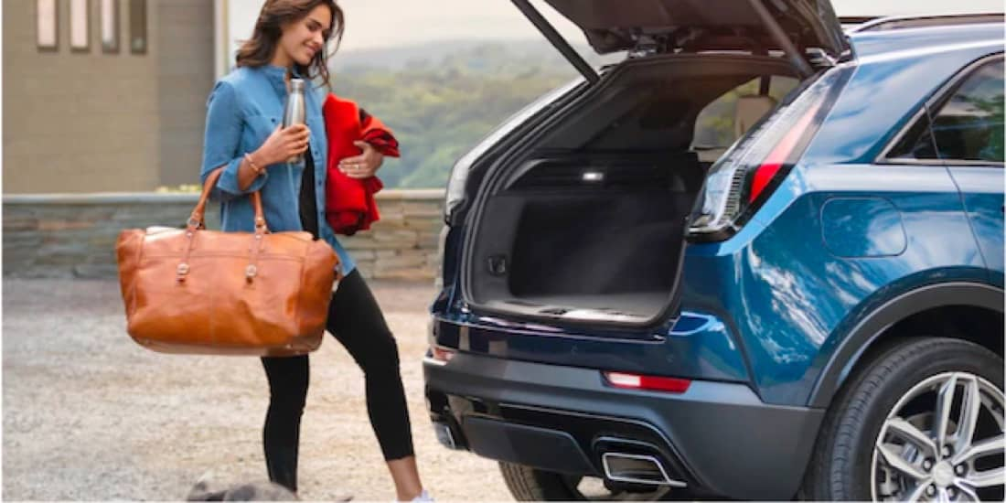 Woman Using the 2021 Cadillac XT4 Available Hands-Free Power Liftgate