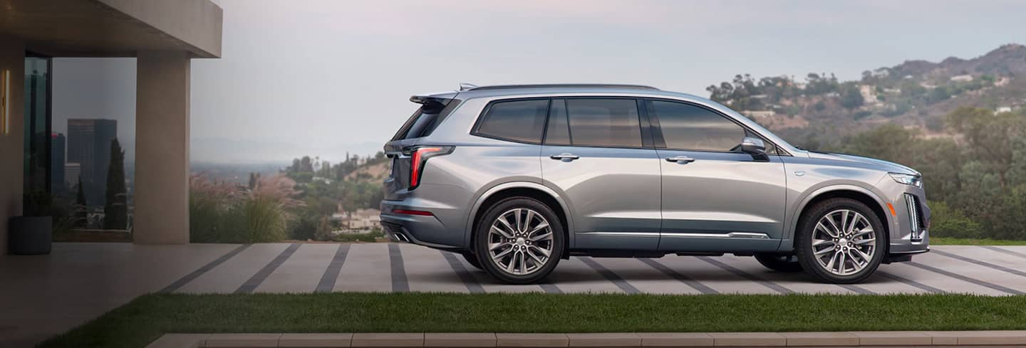 2020 Silver Cadillac XT6 Side View Parked by A House