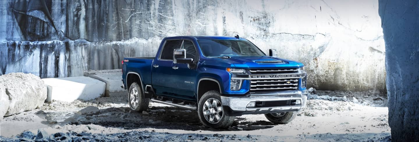 Blue Silverado HD Parked in Snow at an angle
