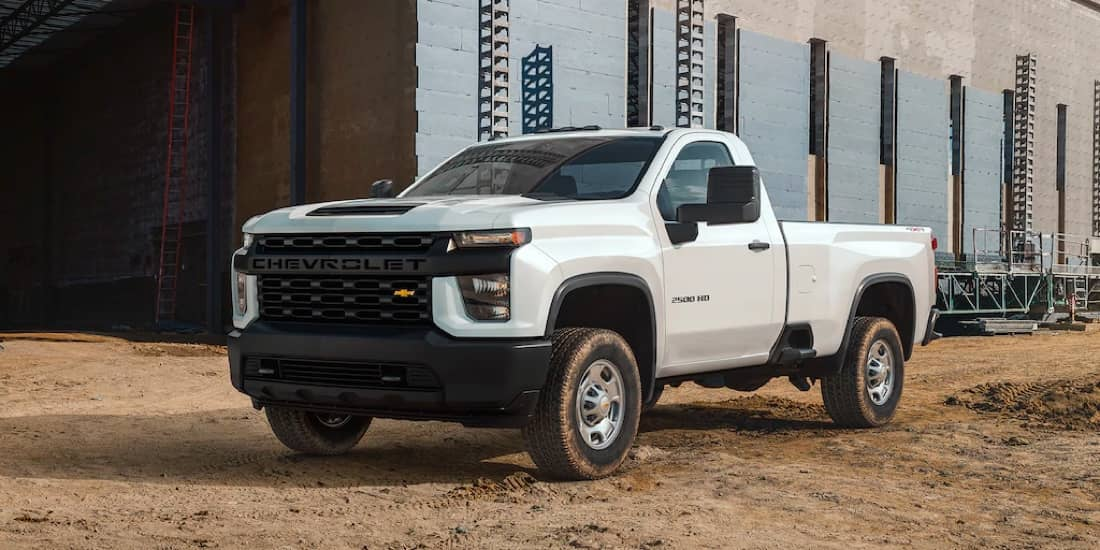 Front facing of a white Chevrolet Silverado HD on a construction site