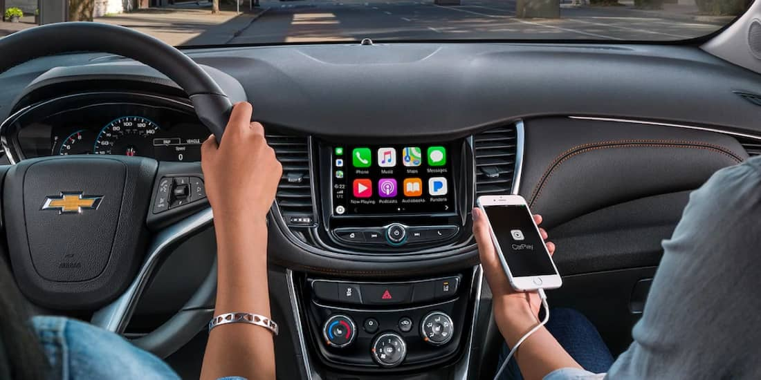 Driver using Apple CarPlay