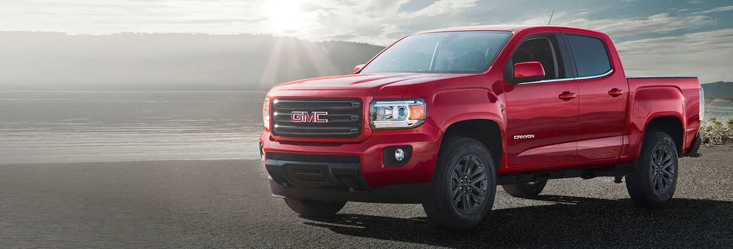 2020 Red GMC Canyon Angled View Parked by a Lake
