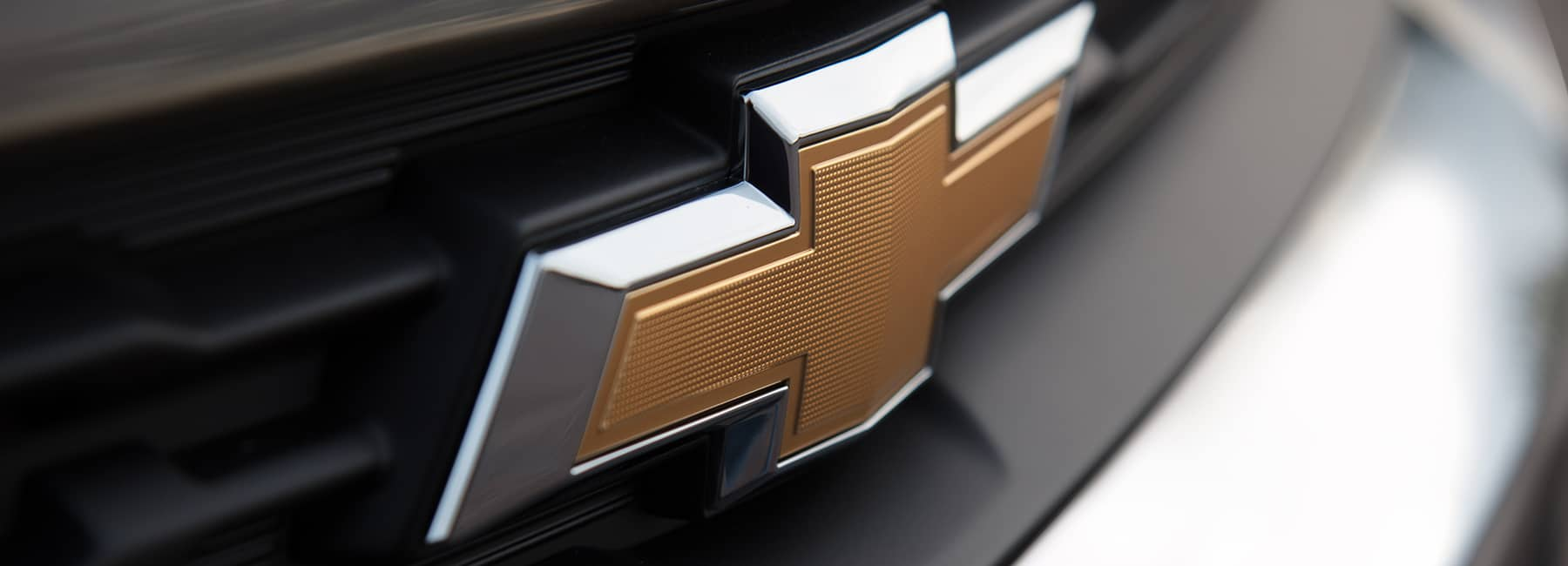 Chevrolet emblem on the front of a truck.