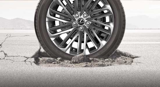 Tire on cracked road