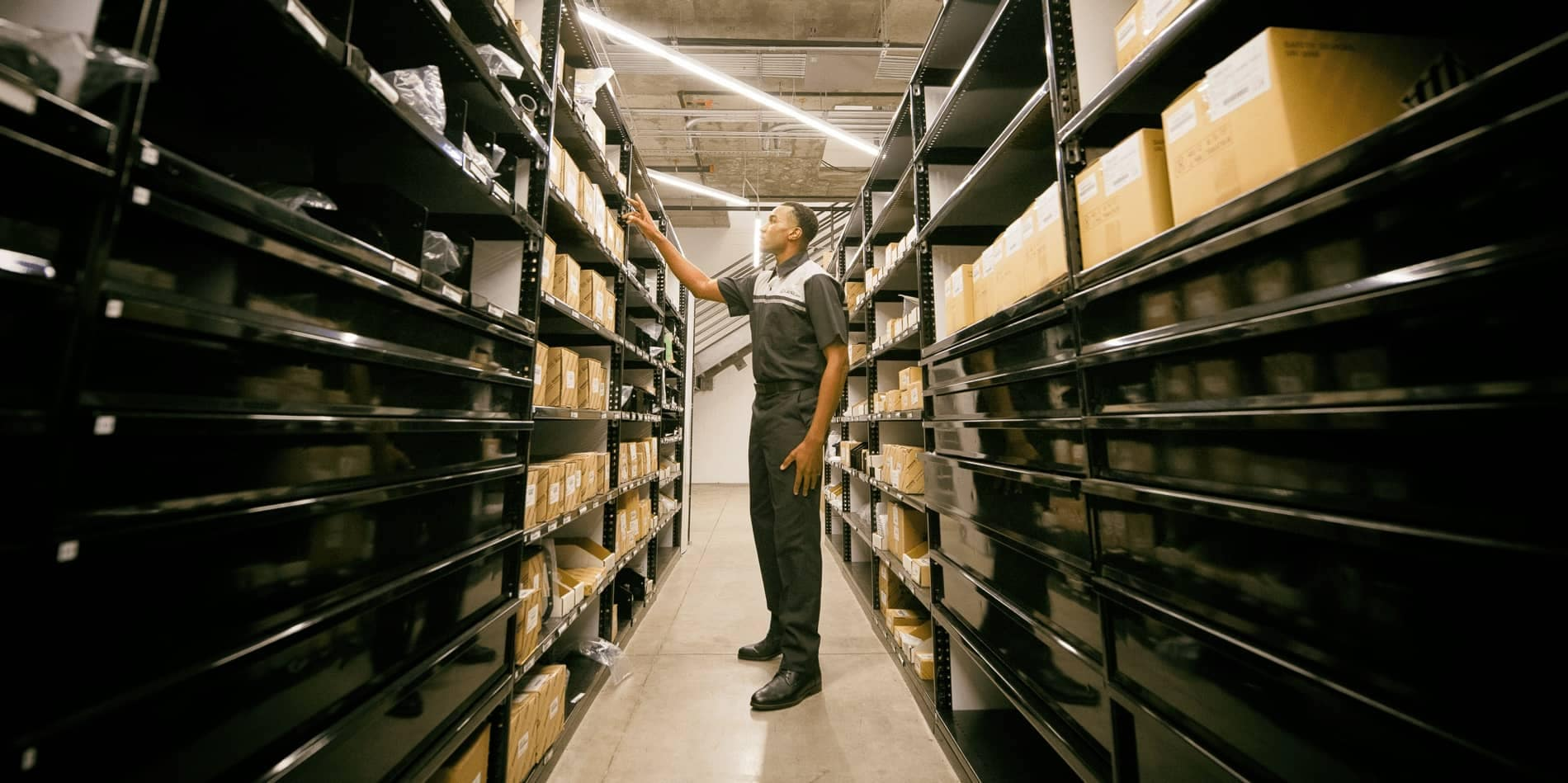 A Lexus Parts Associate looking through the inventory of parts in stock.