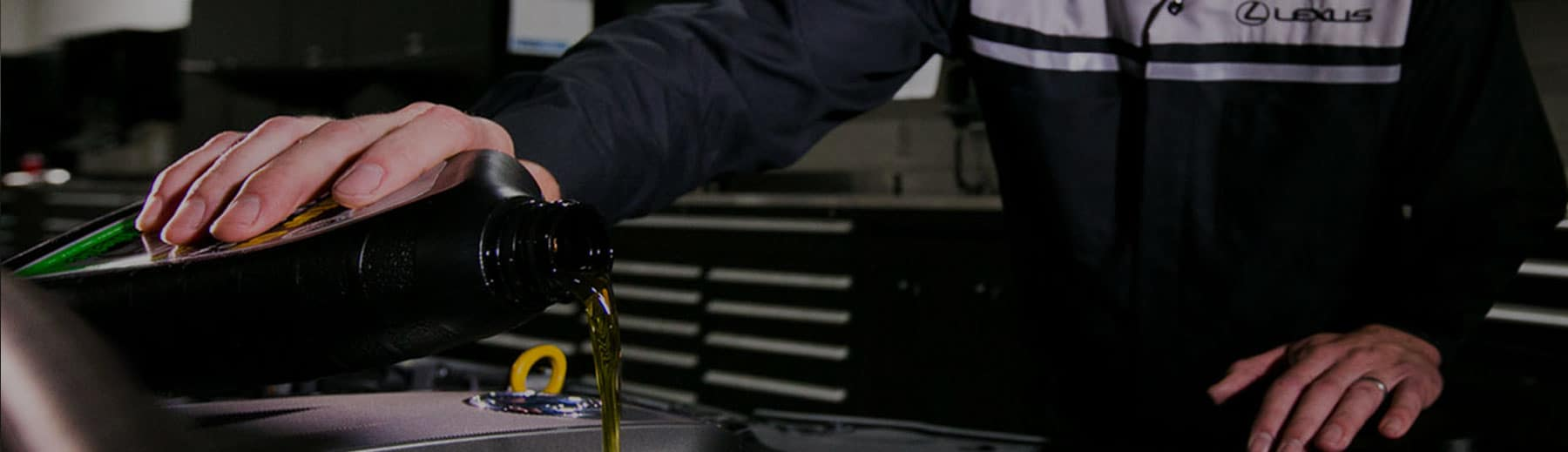 Service Technician pouring new oil into the engine.