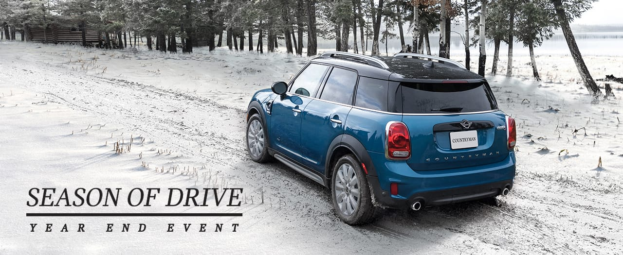 Rear side View MINI Countryman in Island Blue on snow covered road.  Season of Drive Year End Event
