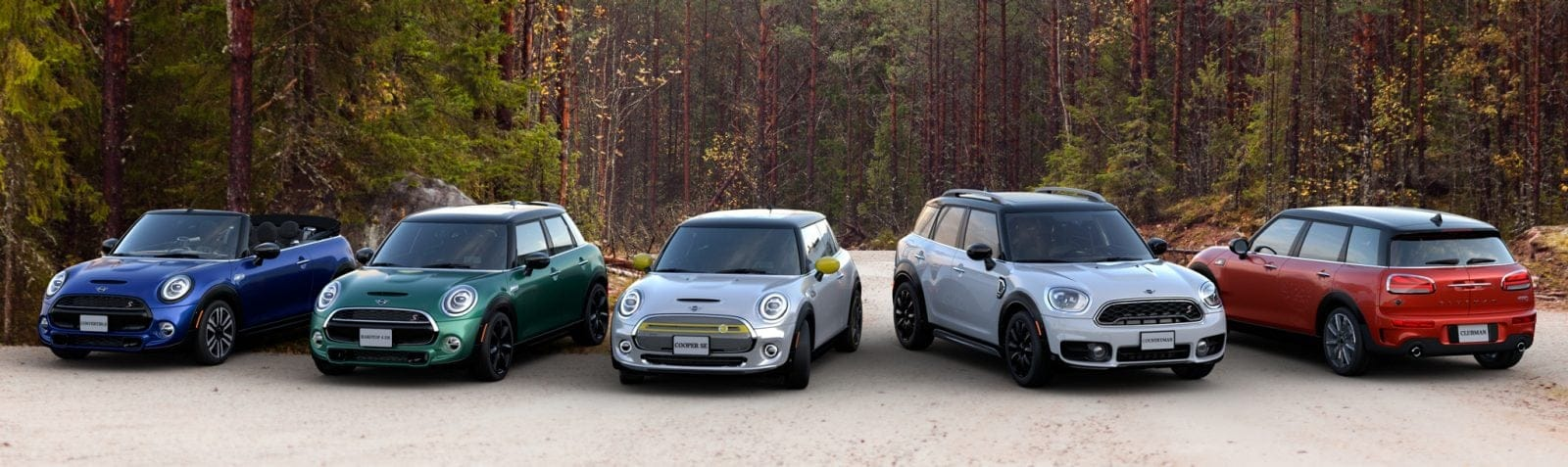 MINI family of vehicles with forest background.