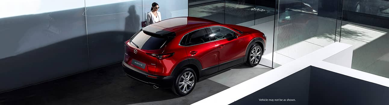 Woman entering 2020 Mazda CX-30