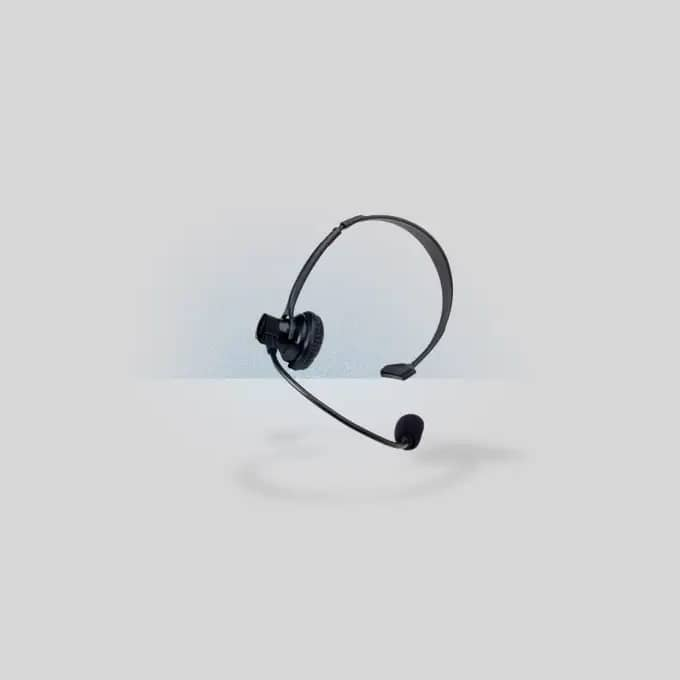 Black telephone operator headset on a grey background