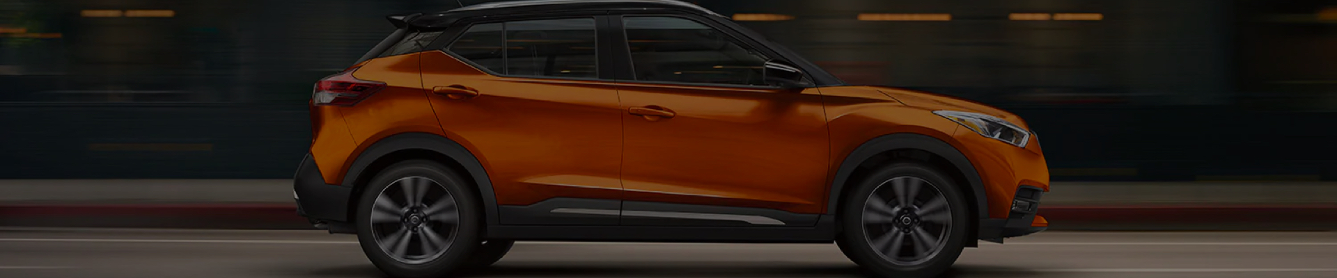 Orange Nissan Kicks side view