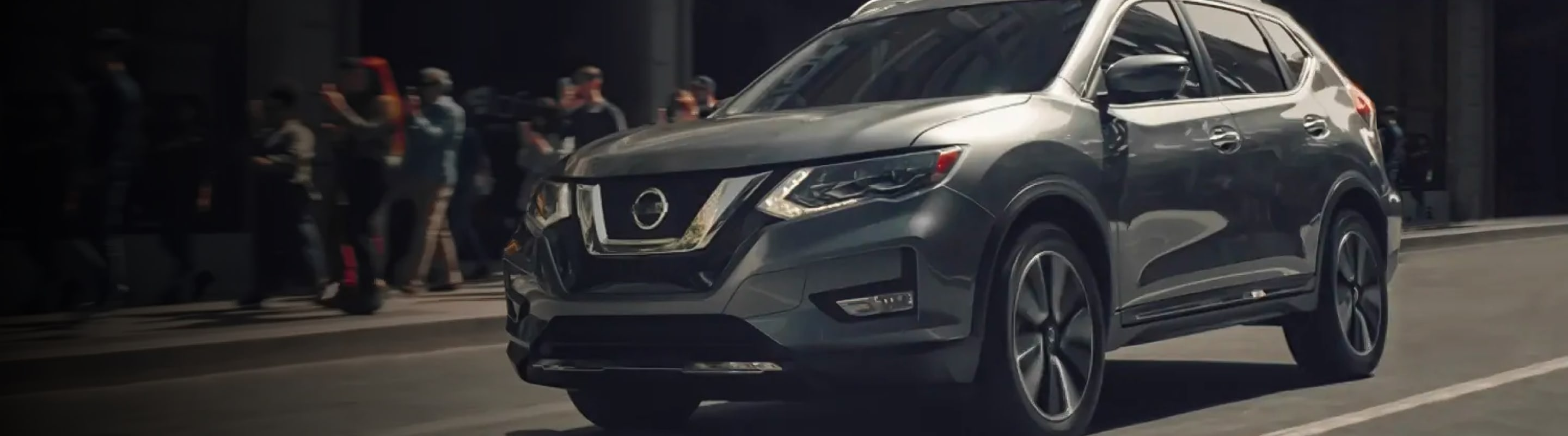 2020 Nissan Rogue driving on a city street
