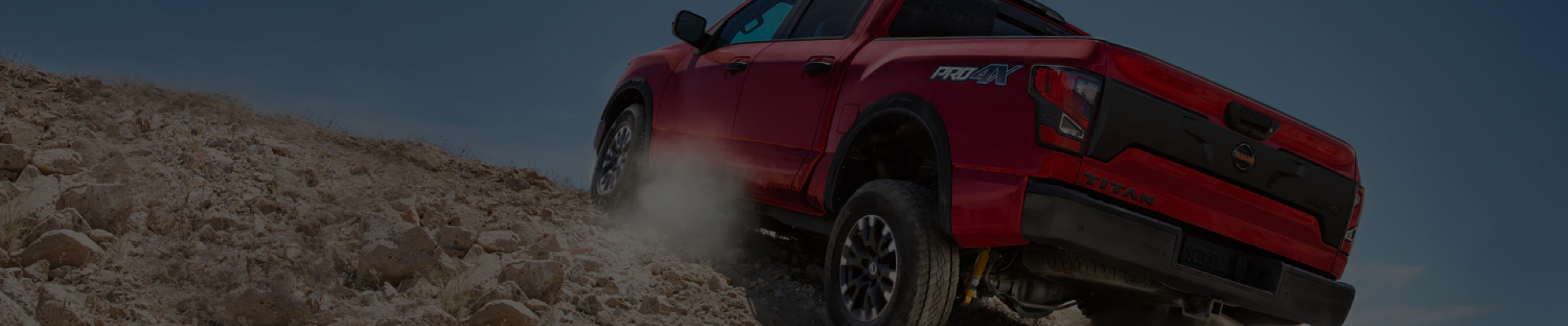 Nissan Titan driving up rough terrain