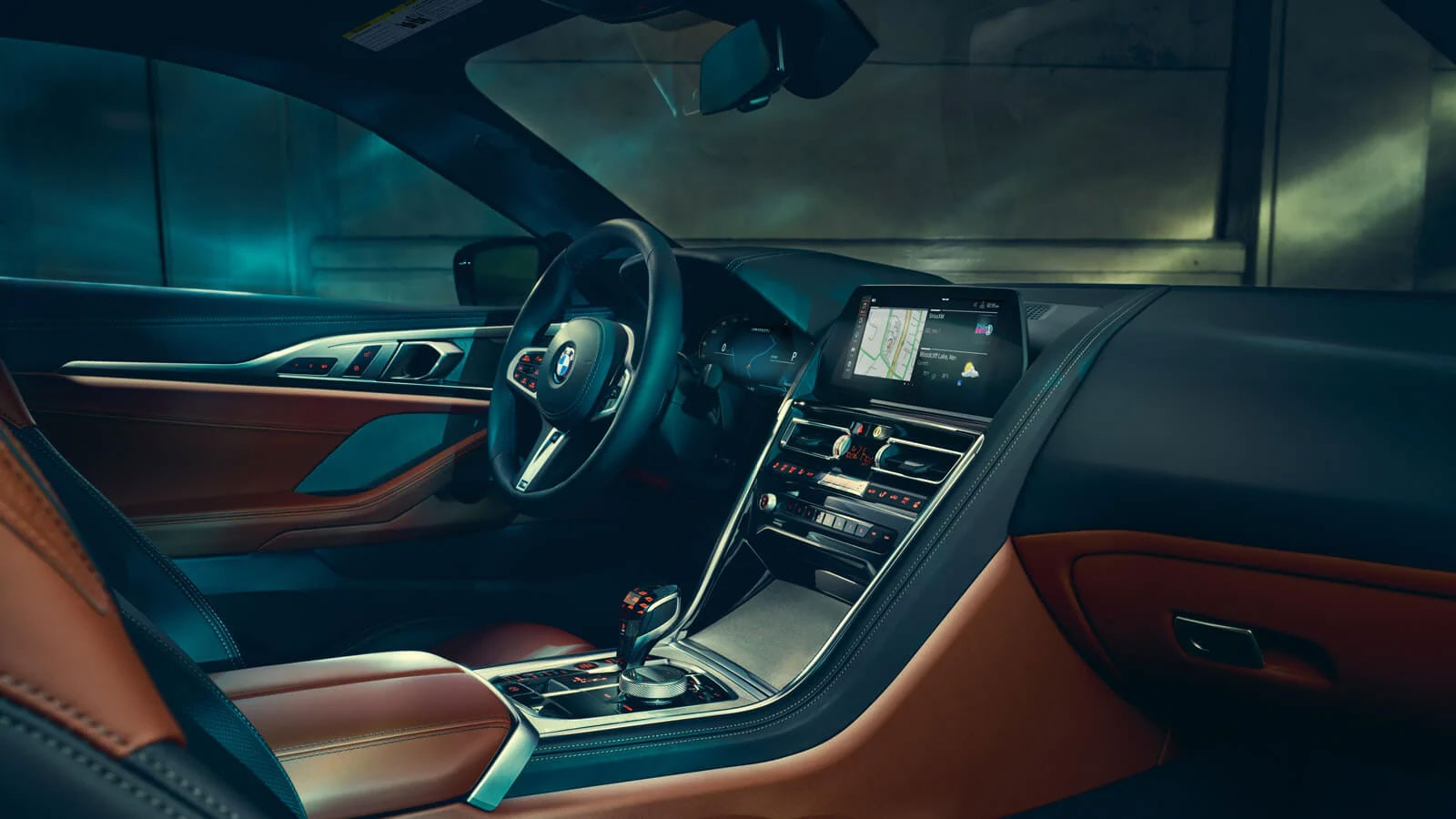 Interior view of the BMW 8 Series Coupe showcasing driver-oriented controls.