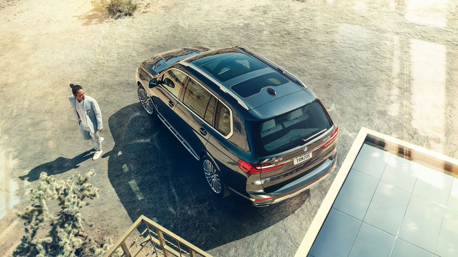 Aerial view of a BMW X7 showcasing the standard three-panel Panoramic Moonroof.