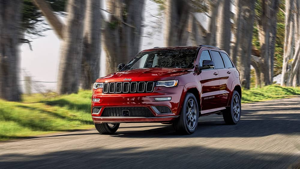 Red 2020 Jeep Grand Cherokee Driving